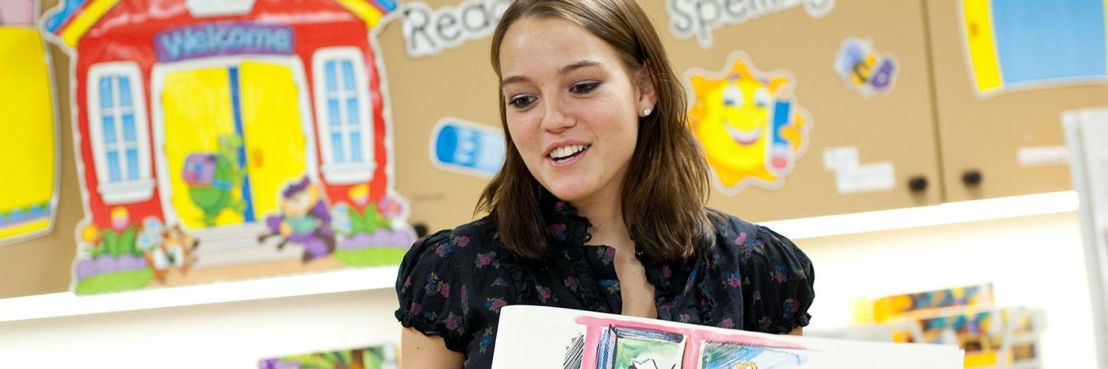 Teacher reading a book to a class