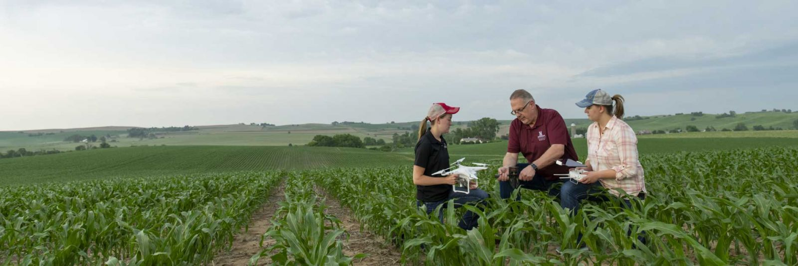 students in field with drone