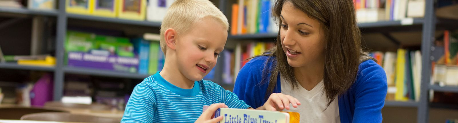 education student reading to a child
