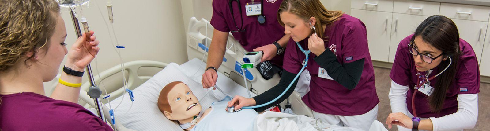 nursing students and medical dummy