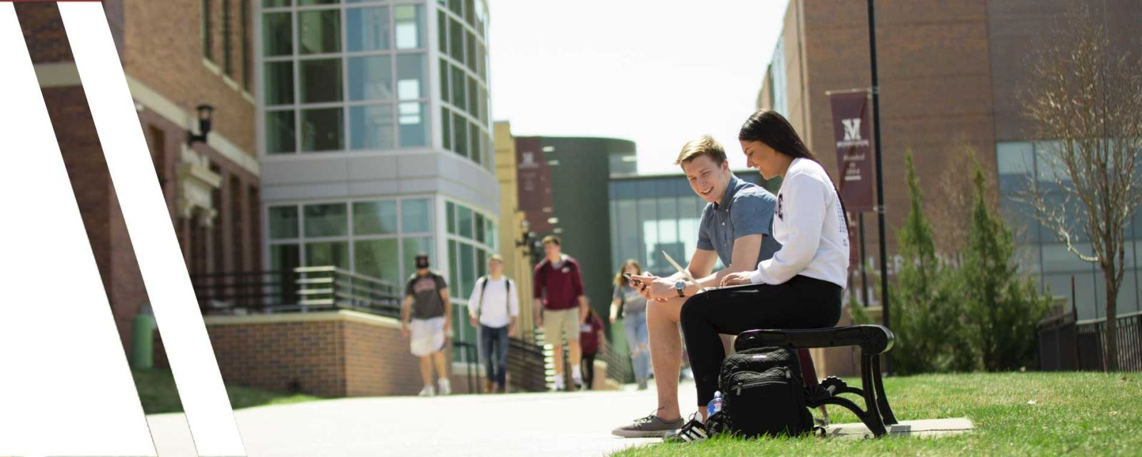 students talking on bench