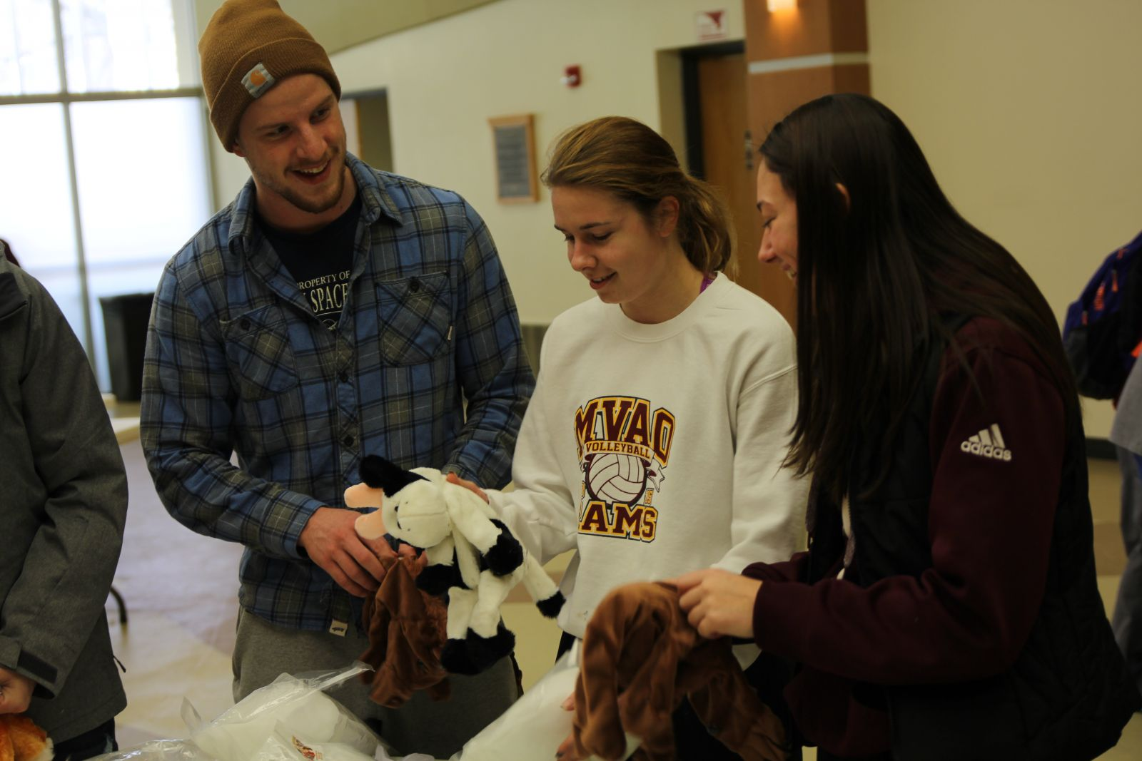 students stuffed with a stuffed cow