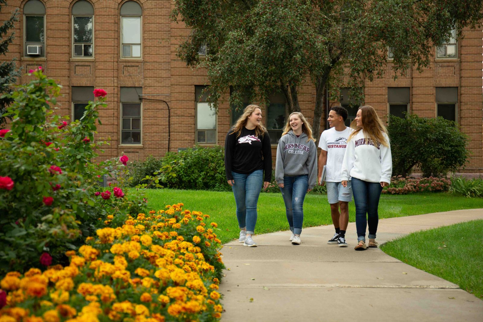 Students walking by Lewis Hall at Morningside College