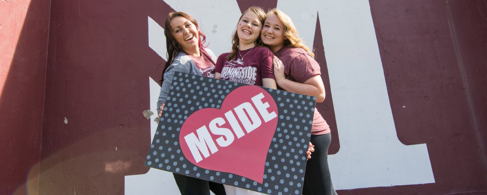 students with mside sign