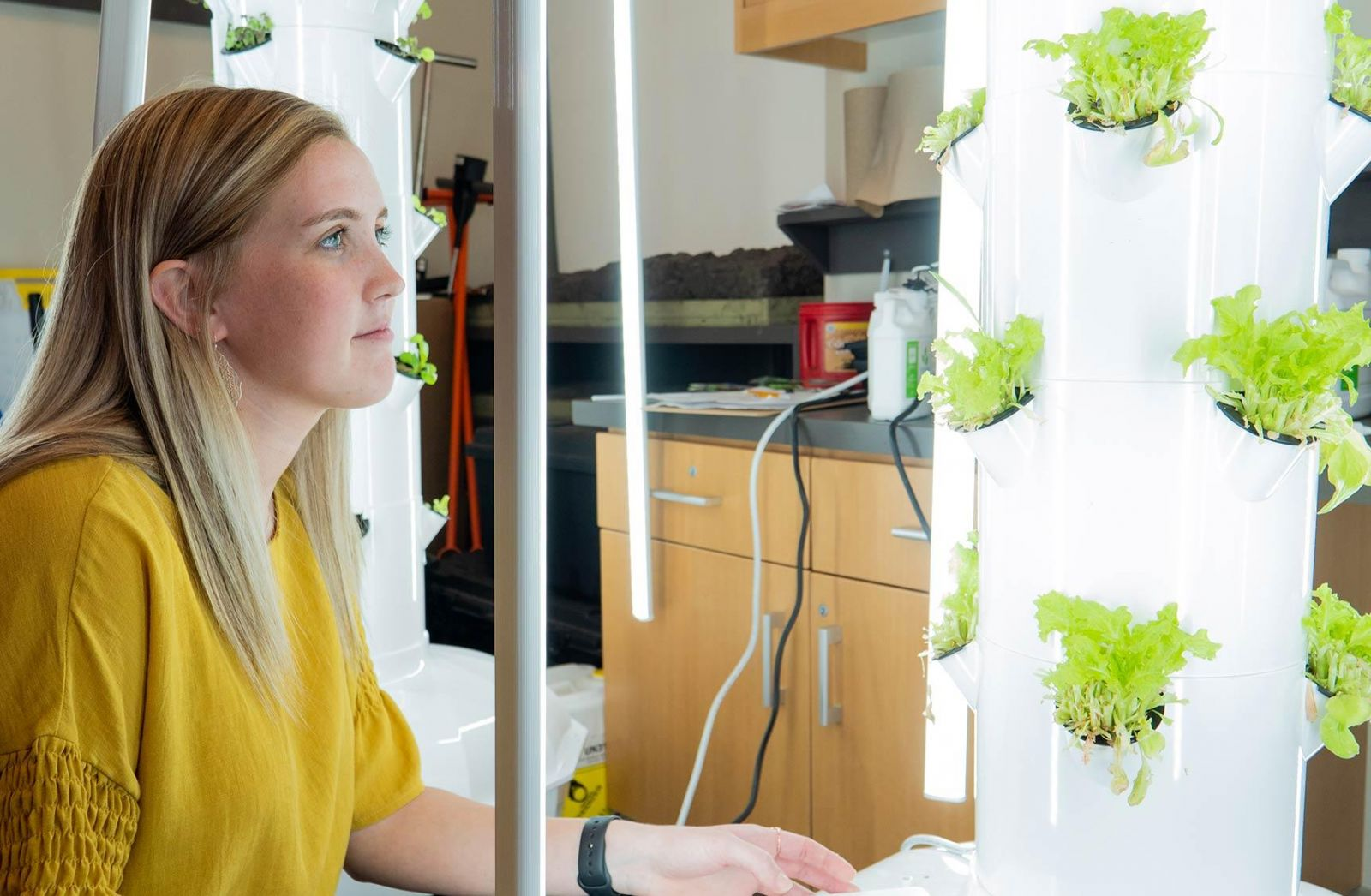 Krista Zavadil looking at a grow tower in an ag classroom at Morningside.