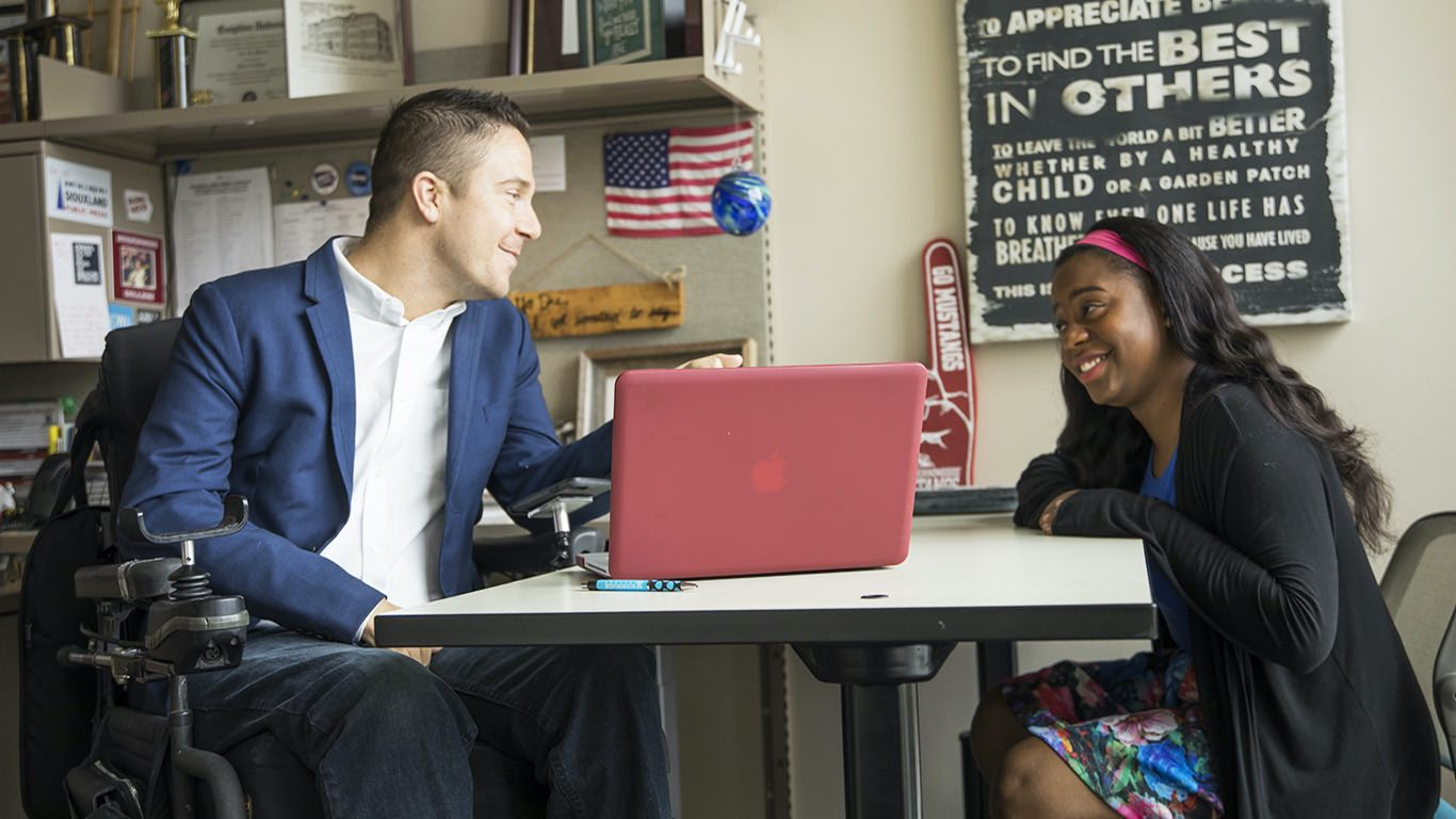Alex Watters advising a student