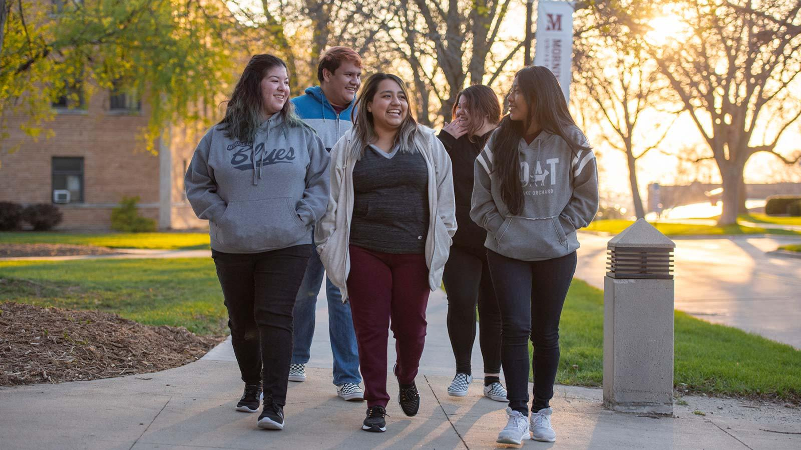 Morningside students walking on campus at sunset