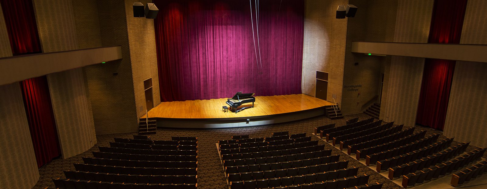 Piano on the stage of Eppley Auditorium
