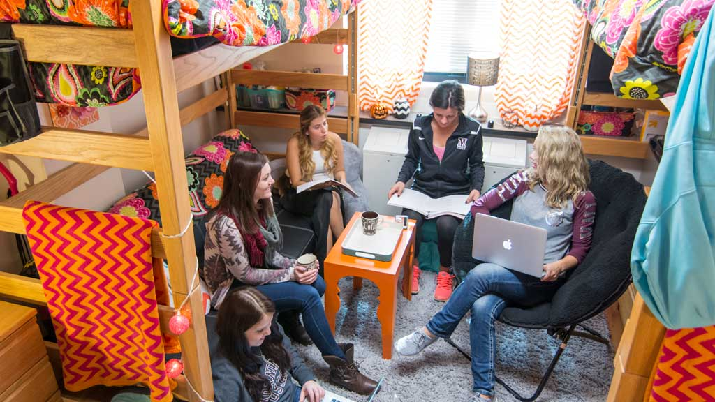 Women studying in dormitory