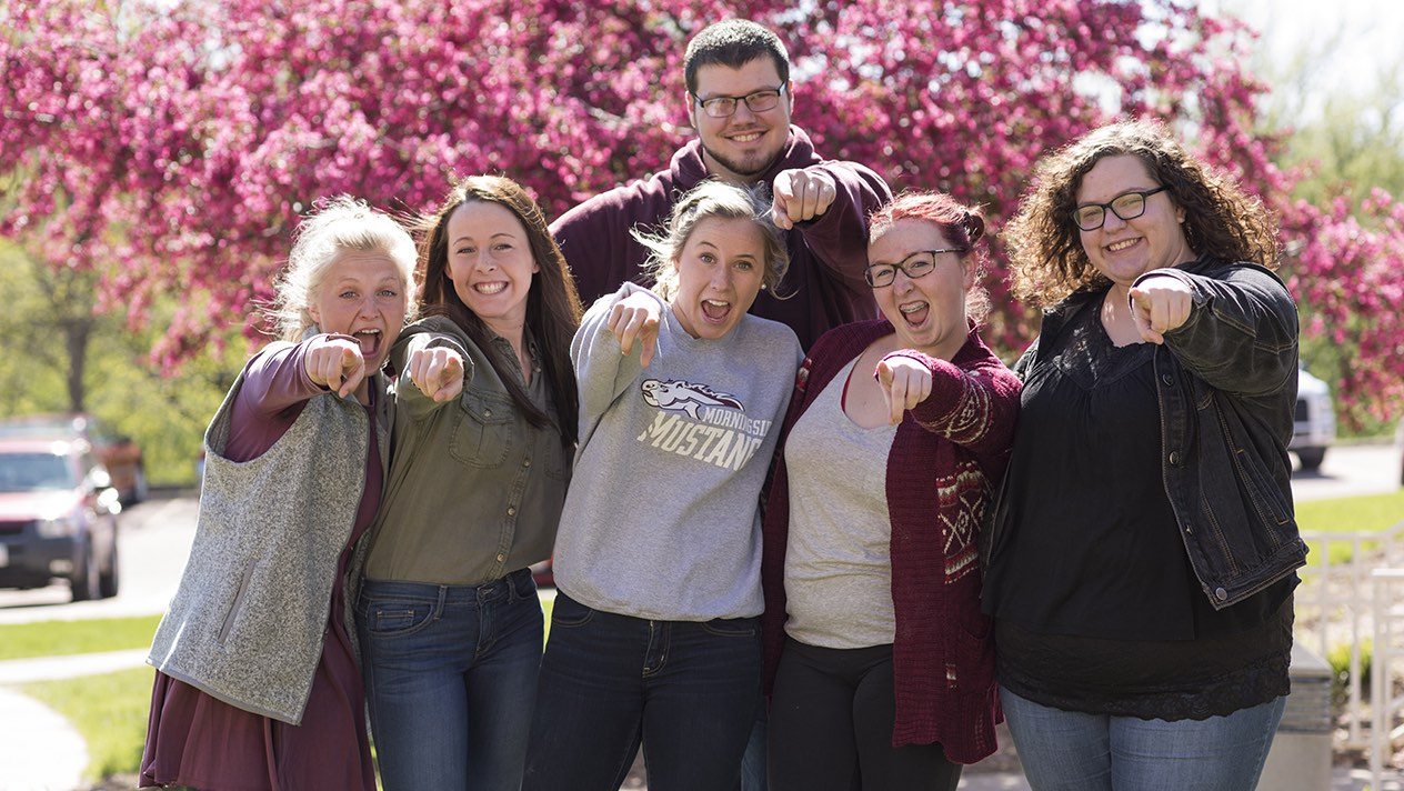 Group of students pointing