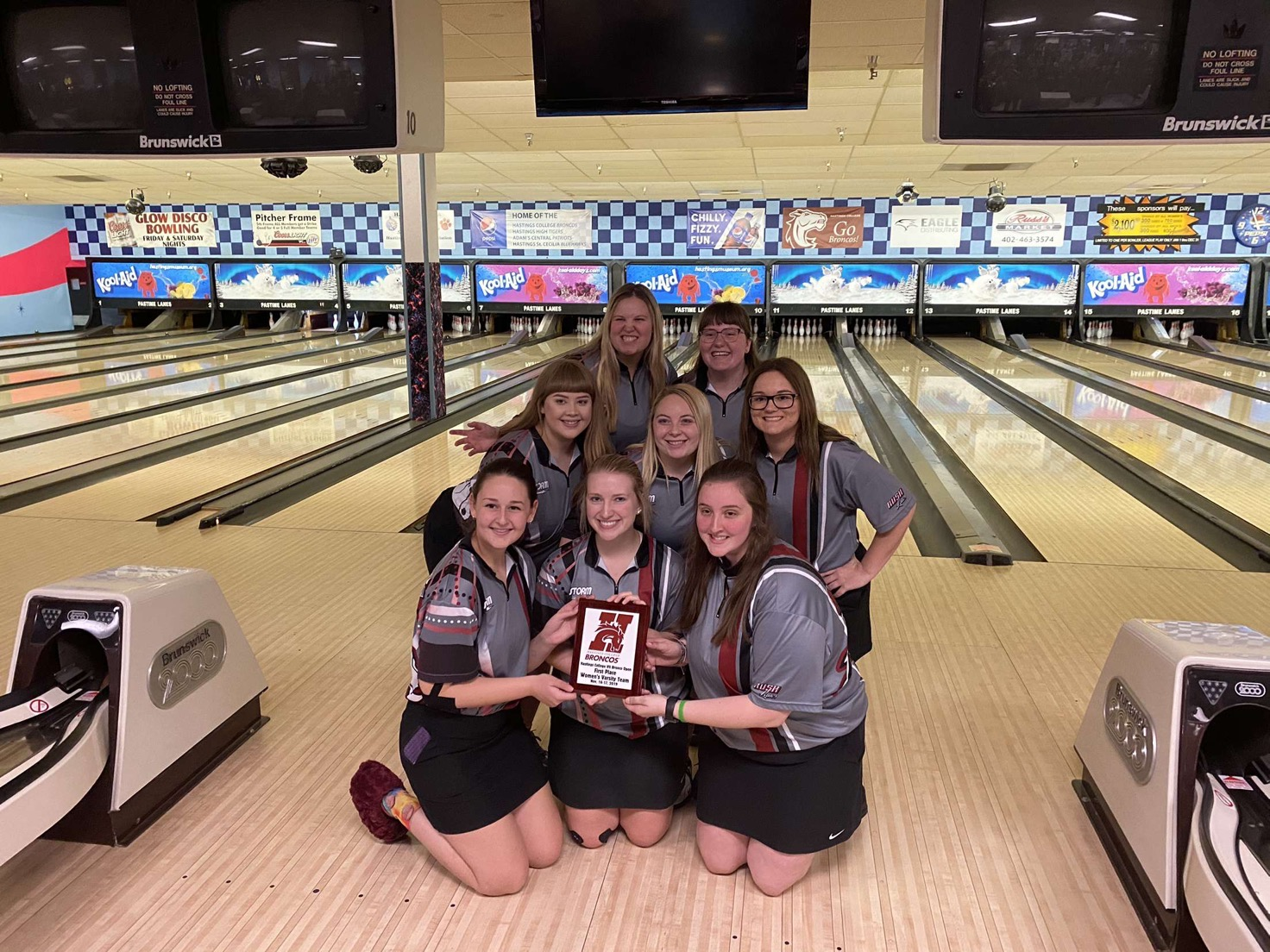 women's bowling team with plaque