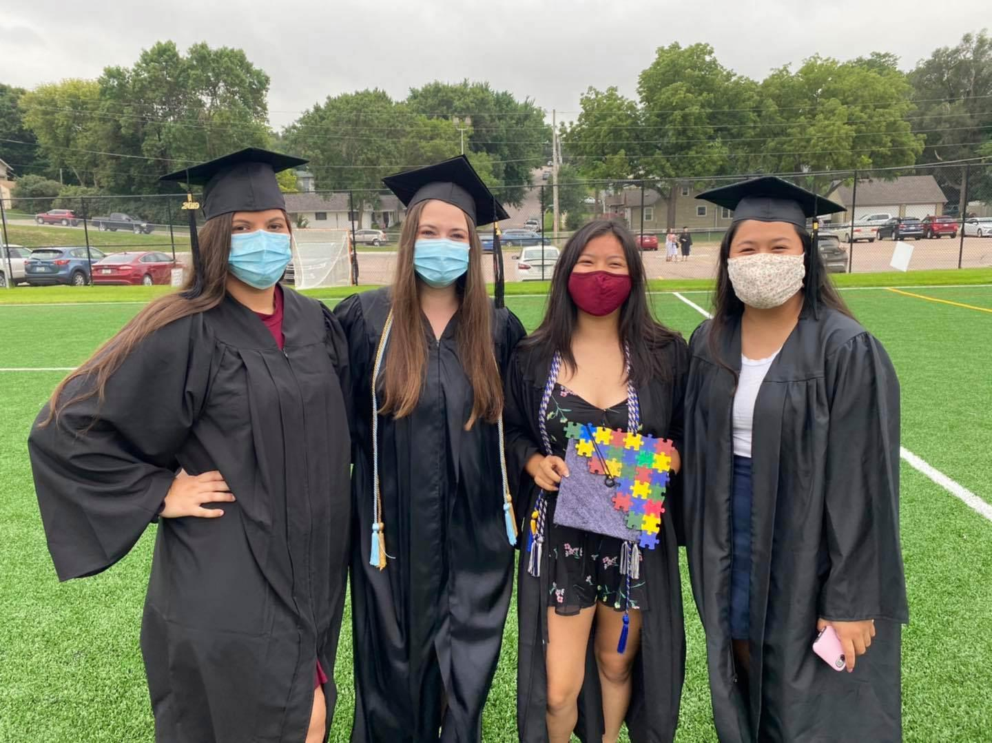 four graduating students august 2020