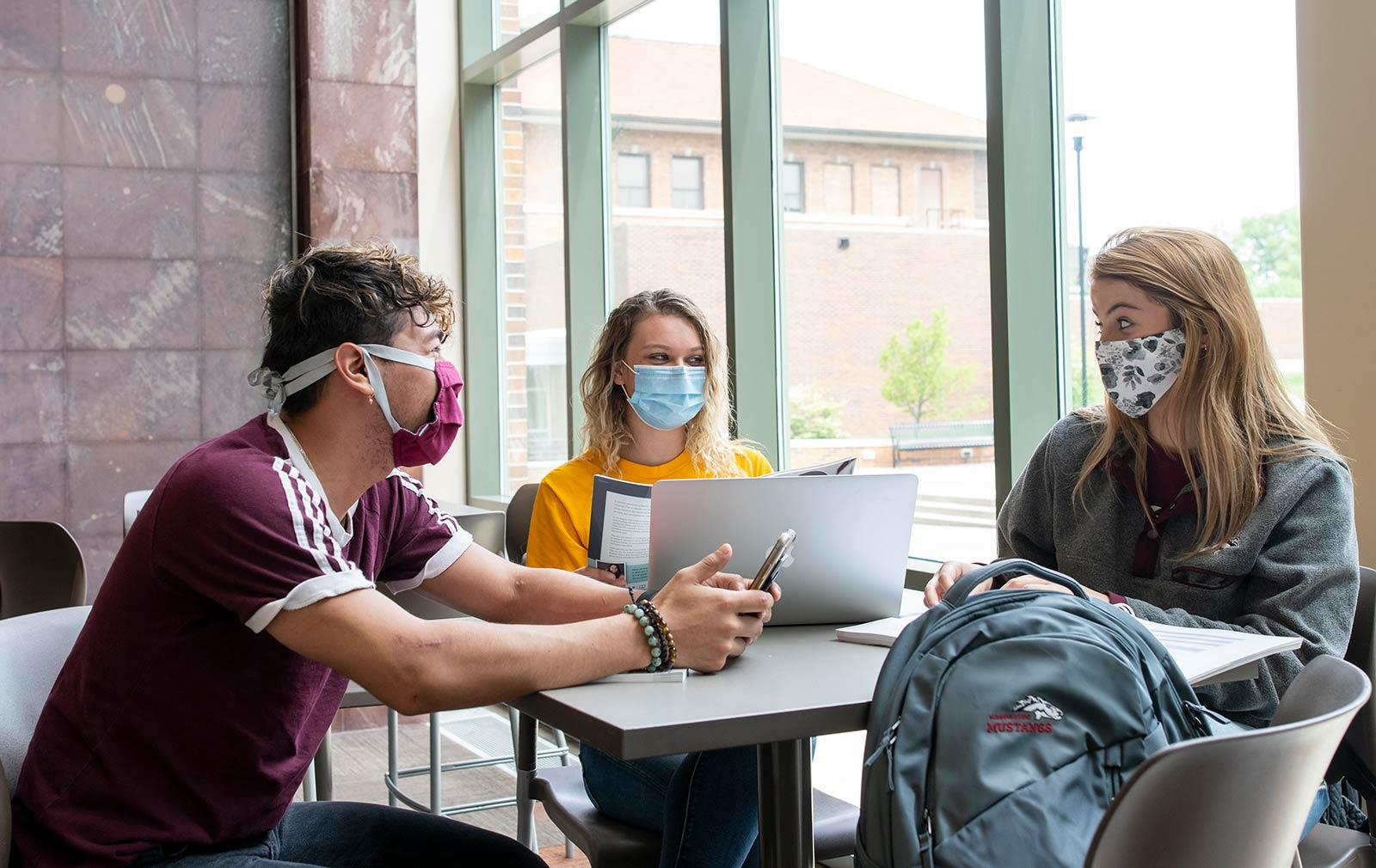 students studying with masks
