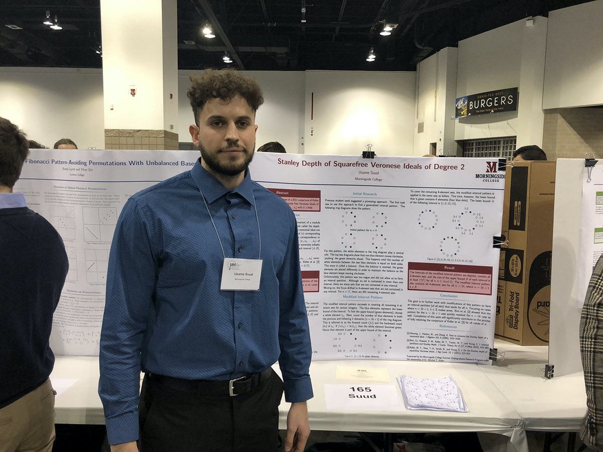 Usame Suud with his poster