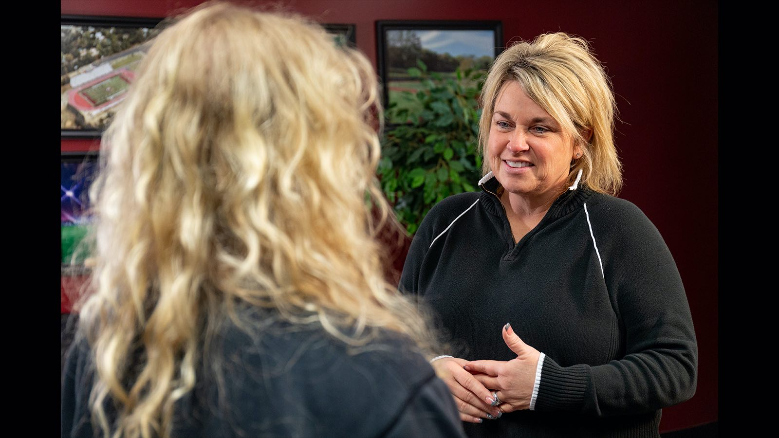 Morningside Coach Jessica Jones-Sitzmann talks with a student