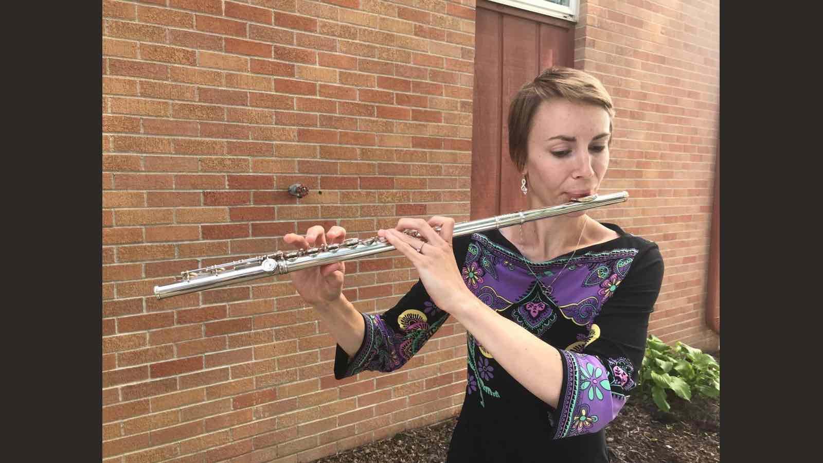 Natasha Hongsermeier-Graves playing the flute