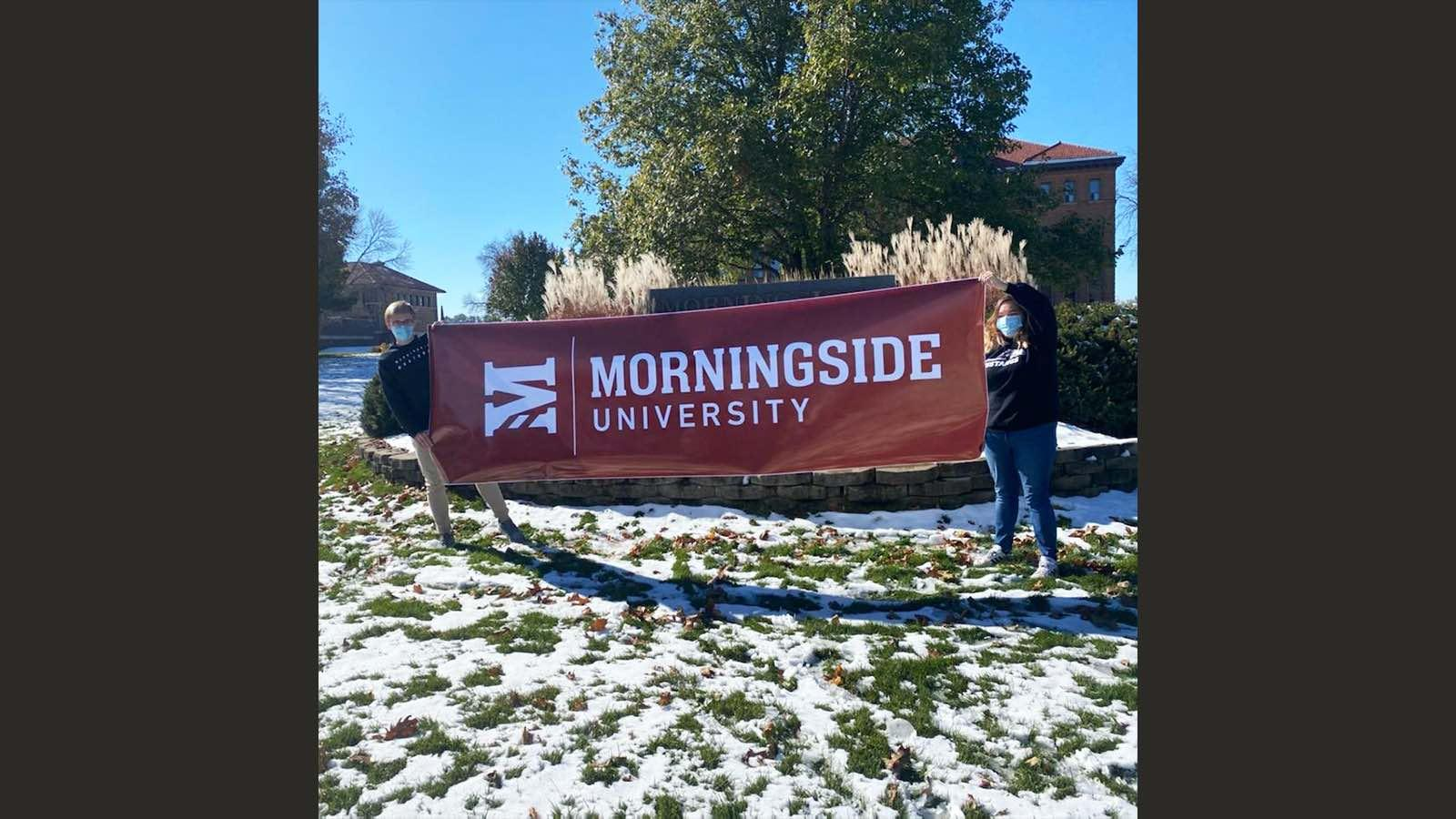 Students with Mside U sign