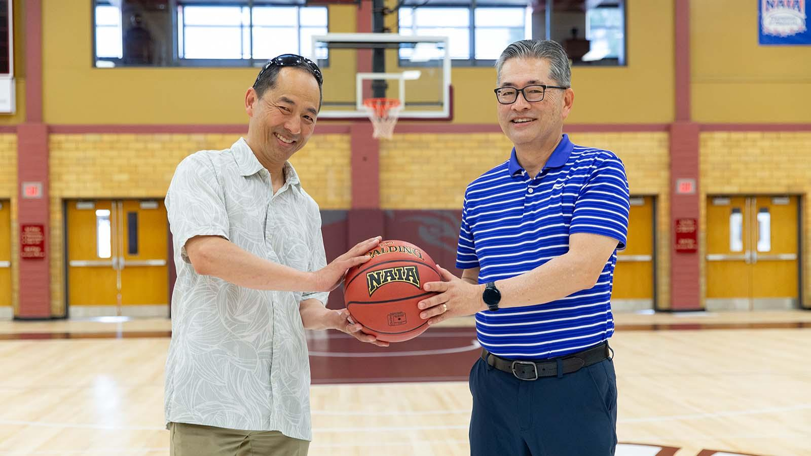 Troy and Jon Kaji were able to visit Allee Gymnasium and shoot a few hoops in the gym where their dad once played.
