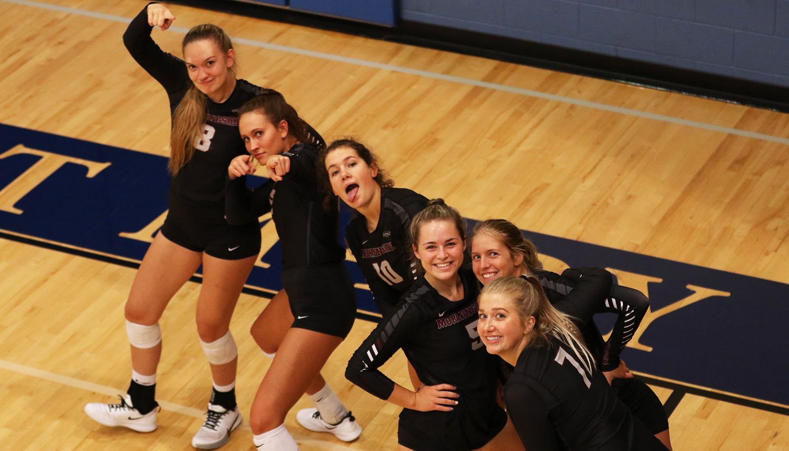 Women's volleyball players being goofy
